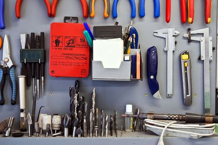 Working tools are accurately located on a workshop wall