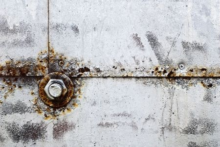 Bolt and nut on a rusty metal surface Stock Photo - 6264973