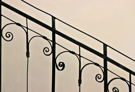 Closeup of vintage wrought-iron banister in the sunlight Stock Photo - 6264982