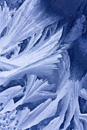 Closeup of beautiful frost pattern on a window photo