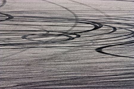 Traces of braking from rubber tyres on asphalt photo