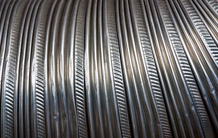 Close up at corrugated structure of metal pipes photo