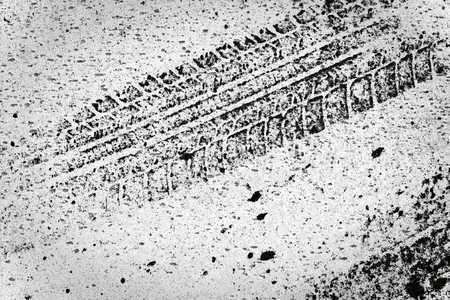 Detail of tyre track on white background