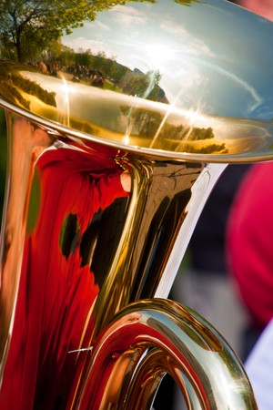 brassy: Close-up of a tuba horn with reflections