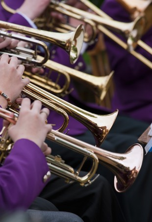 Young musicians are playing on trumpet photo