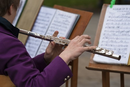 The young musician playing a flute photo