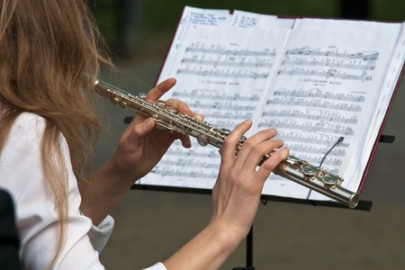 Woman playing flute photo