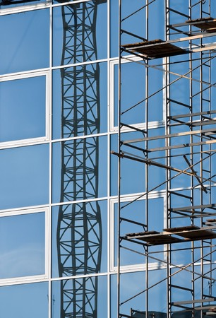 Reflection of building designs in windows of modern office building photo