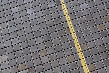 Lane marked yellow on newly laid road photo