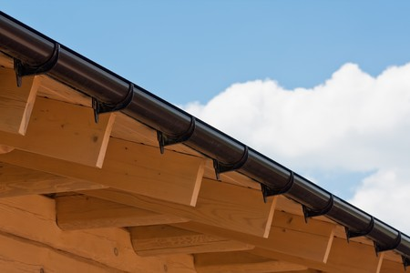 rafters: Wooden rafters of a roof of of home under construction