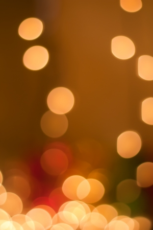 Christmas holiday background of sparkling blurred golden lights