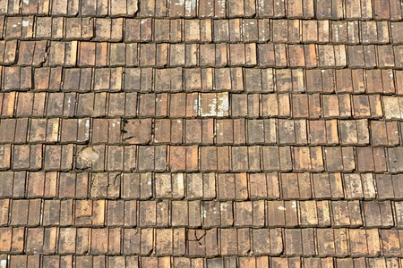 Old red and orange weathered roof tiles