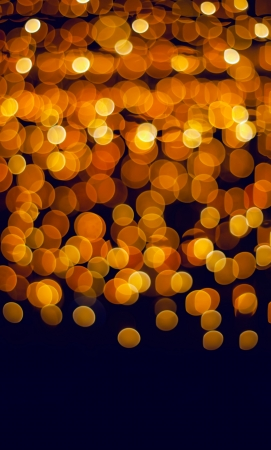 Christmas holiday background of sparkling blurred golden lights photo