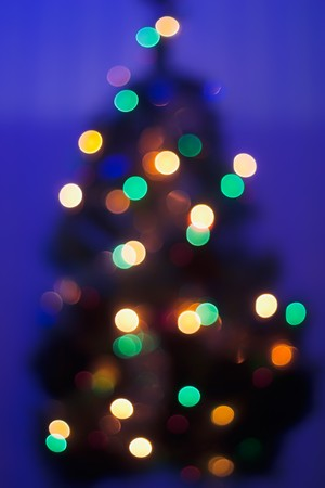 Blurred Christmas Tree Decorated by multiple lights photo