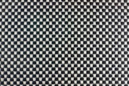 Tightly woven carbon fibre background texture. Macro. Stock Photo - 8297324