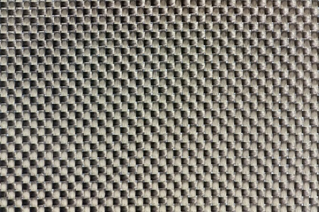 Tightly woven carbon fibre background texture. Macro. photo