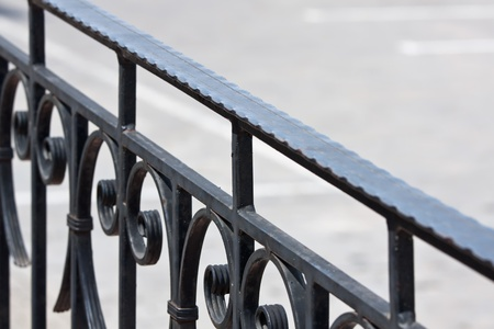 Closeup of vintage wrought-iron banister photo
