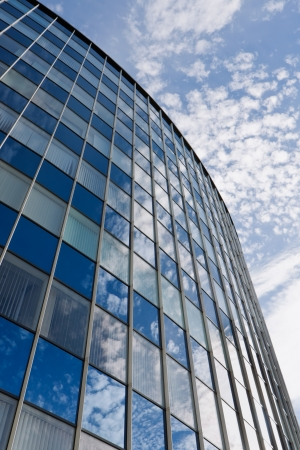 office building exterior: Modern office building with blue sky Stock Photo