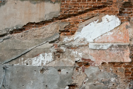 peeled off: Red brick wall with the peeled off plaster Stock Photo