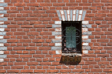 lattice window: Single window in a red brick wall Stock Photo