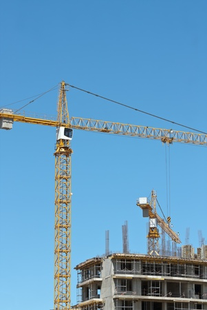 Tower crane on a construction site photo