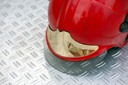 Firefighter helmet on diamond plate steel background  photo