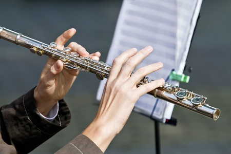 Woman playing on the flutes photo