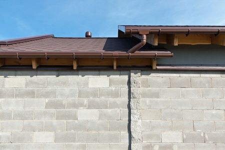 eaves: Gutters on a home Stock Photo