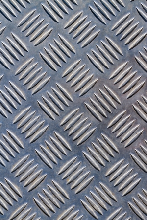 Scratched diamond plate steel background photo