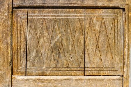 Antique carved wood panel door photo
