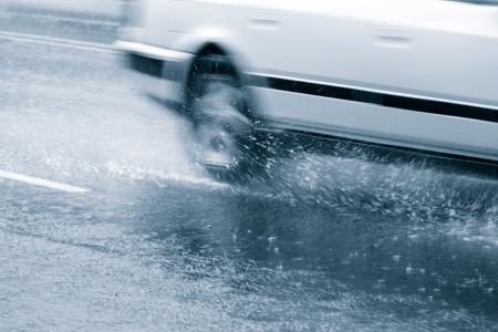 downpour: Car driving through in a downpour Stock Photo