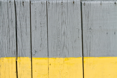 Wooden boards painted yellow and grey photo