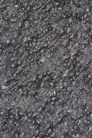Detail of asphalt on a freshly laid road photo