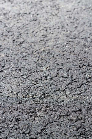 Dark asphalted road surface background photo