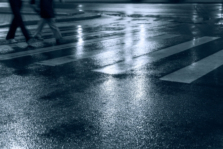 People crossing street at night