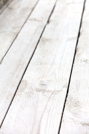 Wooden weathered planks of floor photo