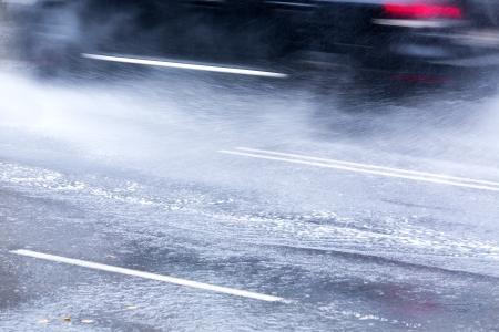 Heavy rain on city street photo