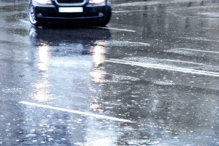 torrential: Car driving through in a downpour Stock Photo