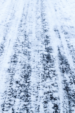 Blue tire tracks in snow photo