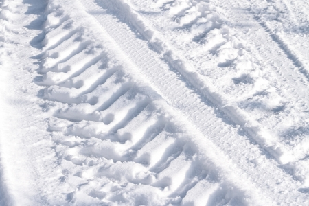 Tire tracks on snow covered field photo