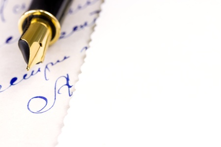 Fountain pen over old letters photo