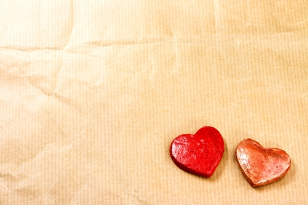Red hearts on brown paper background photo