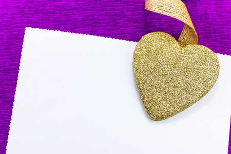 Golden heart with greeting card photo