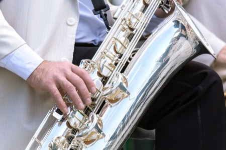 Musician playing on a saxophone Stock Photo - 17598421