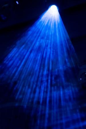 Blue concert lighting and smoke effect photo