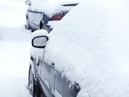 Car on city street after snowfall Stock Photo - 17927015