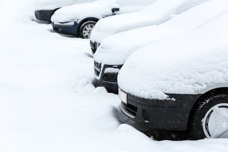 Cars covered with fresh snow  photo