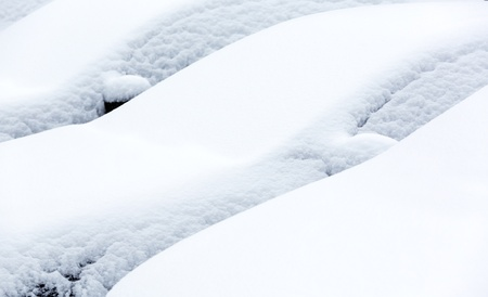 Cars covered with snow in winter blizzard  photo