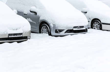 Parked cars after winter blizzard photo