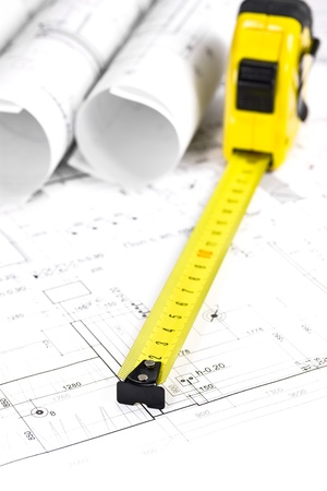 Rolled blueprints and tape measure photo